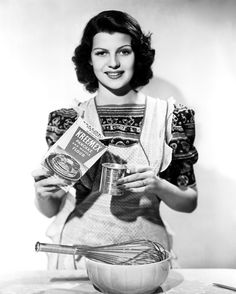 ...Rita Hayworth...glamorous even making pancakes ! (and before her hairline was moved back with electrolysis...)