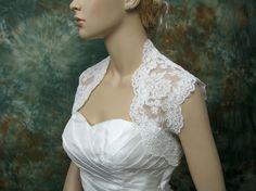 White Alencon lace bolero accessory found via Weddingbee