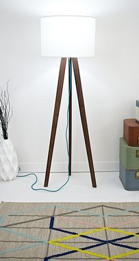 A beautiful mid century modern floor lamp, and we love the pop of color in the braided rayon cord.