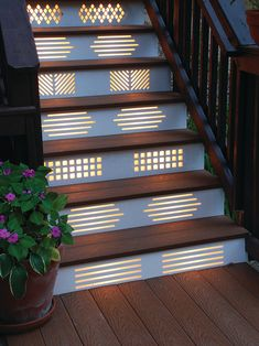 backlit geometric patterns on the stairs add both function and interest to this beautiful wood decking