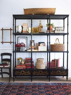 Open and styled bookshelf with photo books and baskets.