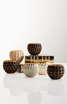 Our Geo Votive packs a lot of style into a compact space. Each is a multi-step marvel, handmade using a base of solid molded glass painted gold, then painted again with a matte white or black.