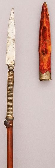 Indian spear with detachable knife head and cane shaft,18th to 19th century, steel, wood (pepper reed), silver, velvet. L. 73 1/2 in. (186.7 cm); L. of head 9 1/8 in. (23.2 cm); L. of sheath 6 5/8 in. (16.8 cm); W. 1 3/4 in. (4.5 cm); Wt. 1 lb. 2.4 oz. (521.6 g); Wt. of sheath 0.8 oz. (22.7 g). Bequest of George C. Stone, 1935, Met Museum.