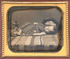 ca. 1850's, [daguerreotype portrait of a sleeping, or possibly deceased, child with toys] Christopher Wahren Fine Photographs