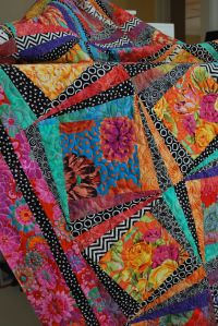 Kaffe Fassett fabrics - rotating log cabin with contrasting fabrics - will try this for sure
