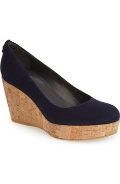 Free shipping and returns on Stuart Weitzman 'York' Wedge Pump (Women) at Nordstrom.com. A slightly lower-heeled version of Stuart Weitzman's beloved 'Corkswoon' shoe, this casually chic round-toe pump is cast in lush suede and set on an earthy cork platform wedge for a look that perfectly merges style and comfort.
