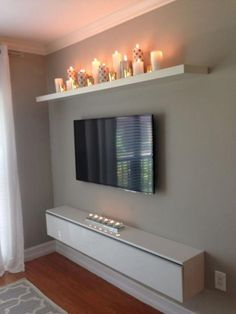 I like the candle shelf.for our bedroom, candle shelf over bed? Tv Wall Decor, Tv Area Decor, Above Tv Decor, Candle Wall Decor, Decor Room, First Apartment, Cozy Apartment, Apartment Ideas, Simple Apartment Decor