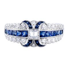 Immaculately detailed ring, conceived in the classic art deco style. Platinum, with approximately one carat of diamonds and one carat of sapphires. Lucie Campbell creates what are arguably the finest modern renderings of this celebrated era.