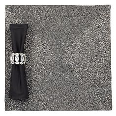 The understated elegance of our charcoal Beaded Placemat provides a sophisticated background for your table setting.