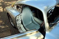Beautiful car and color, I'm assuming the holes aren't bullet holes. On  this nice of a car, one never knows for sure!