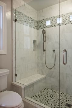 Contemporary 3/4 Bathroom with Arizona Tile, Manhattan, Marble., frameless showerdoor, Handheld Shower Head, Master bathroom