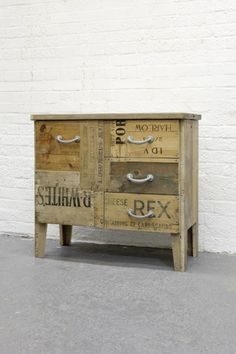 recycled packing boxes for wine, whiskey etc upcucled into a chest of draw. Love the visible typography.
