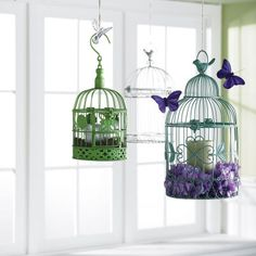 Fill your birdcage lantern with fresh or silk flowers. Cut the twine to your desired length. Thread the twine through the loop on the top of the birdcage lantern. Diy Your Wedding, Wedding Ideas, Candle Lanterns, Candles, Bird Cages, Silk Flowers, Purple Flowers, Bird Houses, Diy Design