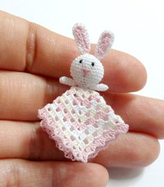 Dollhouse miniature baby safety blanket in scale 1:12 (huggy blanket)    Handmade crocheted by me with cotton sewing thread in white, cream and pink it