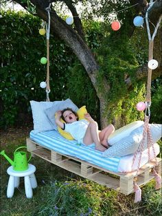 DIY Outdoor Hanging Bed visit mommo design for details (also pictured at top of post)  Your little one will demand his or her nap time if it's in one of these awesome hanging beds! A pallet, a tree, a harness, and some elbow grease, and bonne nuit les petits!