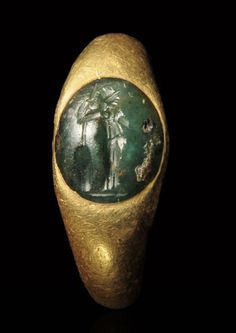 Athena Signet Ring Circa. 2nd to 3rd Century A.D., Roman Measurements: c 4.50 cm., wt. 7.40 g., Size 3 Information: Athena is adorned in a Corinthian helmet and stola. Supporting a shield and spear with her right hand and holding a phiale in her left hand. An owl is seated upon her right forearm. Provenance: D.T. Collection, South Germany, 1996. GM1331 Jerome M. Eisenberg, Inc. © 1999 - 2017