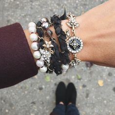 Featuring enamel insignias, pops of pearls + threaded chains, our layerable Souviens bracelets make an eye-catching arm soirée worthy of the season!