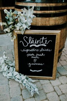 Gold-framed chalkboard wedding signage | Image by Jessie Schultz Photography