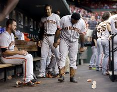 Pablo Sandoval wears a pair of lucky cowboy boots courtesy of Madison Bumgarner in the dugout on May 29.