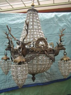 Stag head chandelier. I want one more of these so that I can have one over each side of a long dining table and probably 4 more pairs of the matching sconces so that there are three each on the longer wall and two each flanking the doors. Actually--I'd need 5 sets of the sconces; I want to keep the ones I have in the bedroom.