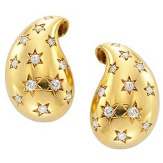 Cartier Retro Diamond Gold Ear Clips | From a unique collection of vintage clip-on earrings at http://www.1stdibs.com/jewelry/earrings/clip-on-earrings/