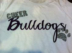White tee with cheer bulldogs in glitter! Contact  Sales@lmspiritgear.com