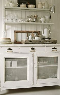 Love these cabinets . Cute cottage kitchen.