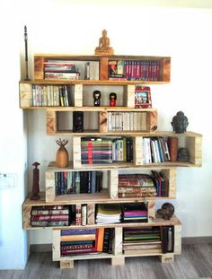 Upcycled Pallet Book Shelves  Here is a unique sort of wall shelf. Look carefully at the entire structure of this wall shelf, this seems to be one unit but actually a number of wooden pallet boxes are combined together making them look like a single unit wall shelf. This is certainly a master art craft made by a pallet lover who knows the essence of real art. It has all the qualities of a good wall shelf, it is quite spacious that a number of accessories are stored inside it.