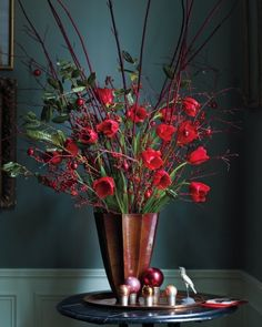 The perfect holiday flower arrangement: French tulips, holly, winter-berry, and red twig dogwood