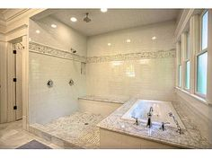 """Spa-like master bath with enormous """"rain head"""" shower and jetted tub."""