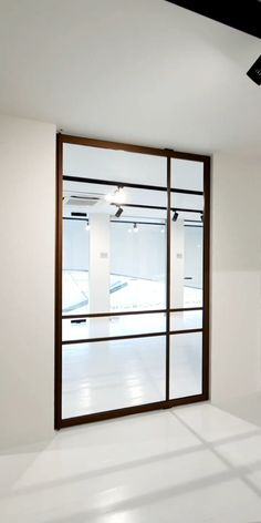 Bronze crittall style pivot door, Modern bronze crittall style glass pivot door made from anodized aluminium with invisible self-closing pivot hinge. Find local resellers on www. Interior Design Minimalist, Office Interior Design, Office Interiors, Black Interiors, Minimalist Bedroom, Exterior Design, Crittall, Revolving Door, Pivot Doors