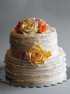 Simple cake - would be cute and easy so I'd have more time to do the groom's cake which will be more fun!