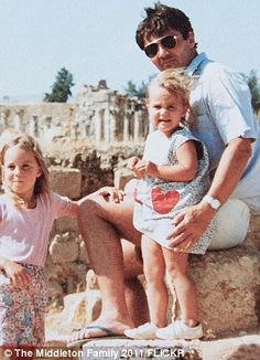 in 1986, four-year-old Kate is pictured with her flight dispatcher father Michael and younger sister Pippa at the ancient ruins of Jerash in Jordan.