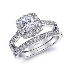 This gorgeous halo engagement ring holds a 5.5mm princess cut diamond. Pave set diamonds and milgrain edging decorate the shank. Shown with matching diamond band. Copy. #coastdiamond