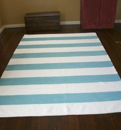 DIY painted rug- love the stripes and the color!