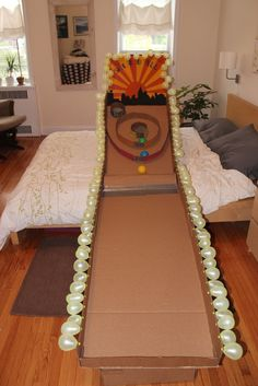 cardboard skeeball...no directions, just picture...kids will have a blast with this cardboard creation