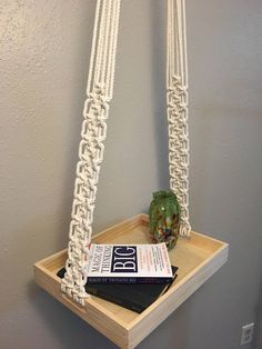 Macramé hanging table made with 100% natural organic cotton with unique tassel detail at the top. Use as a side table for plants, vases, books, fruit, a lamp, really, anything you want to put there! Measures 56 inches from top to tray.