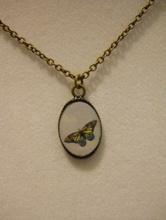 Rainbow Butterfly 12x17mm Pendant on Fine by PaisleysandPortraits