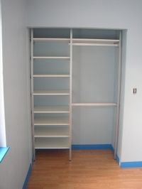 Small closet solution - shelves are a must, but fewer, to hang long garments below them.