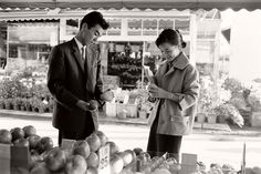 Takahide Inayama (Age 20), left, and his girlfriend, Mitusyo Ogama (Age 20), both are university students. Seen here picking out apples on a date near their university. 1959