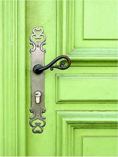 Awesome shade of green on this door with pretty hardware.  I'm actually leaning toward this color for my living room walls!