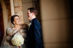 Bride with beautiful fur shrug for Notre Dame winter wedding