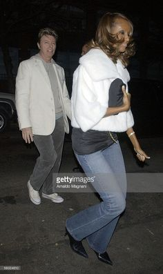 Model Iman and musician David Bowie arrive at Bette Midler's 60th birthday surprise party at the oldest Synagogue in New York City, Angel Orensanz, in Lower East Side December 2, 2005 in New York City.
