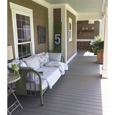 Farmhouse porch - love the daybed eclecticallyvintage.com