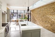 A home refurbishment and extension in South West London designed by Granit Chartered Architects. Exposed Brick Kitchen, Brick Wall Kitchen, Open Plan Kitchen Living Room, Exposed Brick Walls, Brick Slips Kitchen, Kitchen Interior, Kitchen Design, Kitchen Ideas, Kitchen Layout