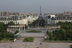 """A view of the Tianducheng development in Hangzhou, Zhejiang Province, on August 1, 2013. Tianducheng started construction in 2007 and was known as a knockoff of Paris with a scaled-replica of the Eiffel Tower, standing 108 meters tall, and Parisian houses. Although designed to accommodate at least ten thousand people, Tianducheng remains sparsely populated and is now considered as a """"ghost town"""", according to local media. (Reuters/Aly Song)"""