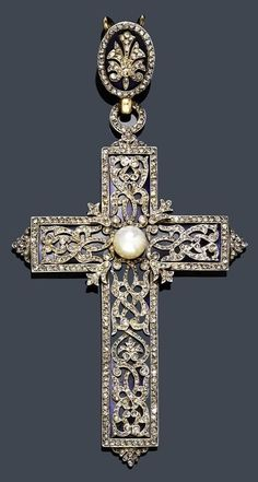 DIAMOND, ENAMEL AND PEARL CROSS PENDANT,~ France ca. 1890. Silver over red gold. Blue- enamelled background, and an overlay of openwork silver with volute and arabesque motifs, set with rose-cut diamonds, and a single natural Pearl.
