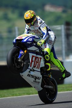 Rossi's party piece. One leg off wheelie.  You cannot take the boy out of the man.
