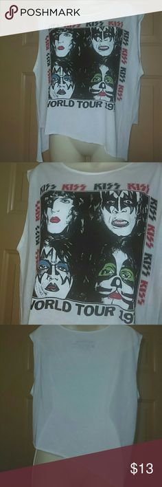 """KISS T SHIRT-SIZE SMALL-NWOT -Kiss T shirt -Size Small -New, never worn -Sleeveless -Uneven bottom hem -Armpit to armpit measures 20"""", straight across -Shoulder to bottom hem measures 20""""- 25"""" -60% Cotton, 40% Polyester -Live Nation Merchandise -Cool t shirt Live Nation  Tops Tees - Short Sleeve"""