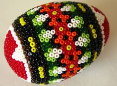 Beaded eggs can also be found in Eastern Europe. In Romania, in particular, eggs are sometimes painstakingly covered with tiny seed beads to form geometric images.